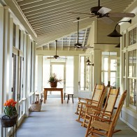 Rocking Chairs and Wooden Table on a Screened In Porch